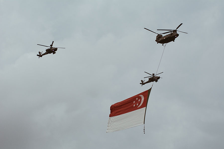 3 helicopters flying the singapore flag