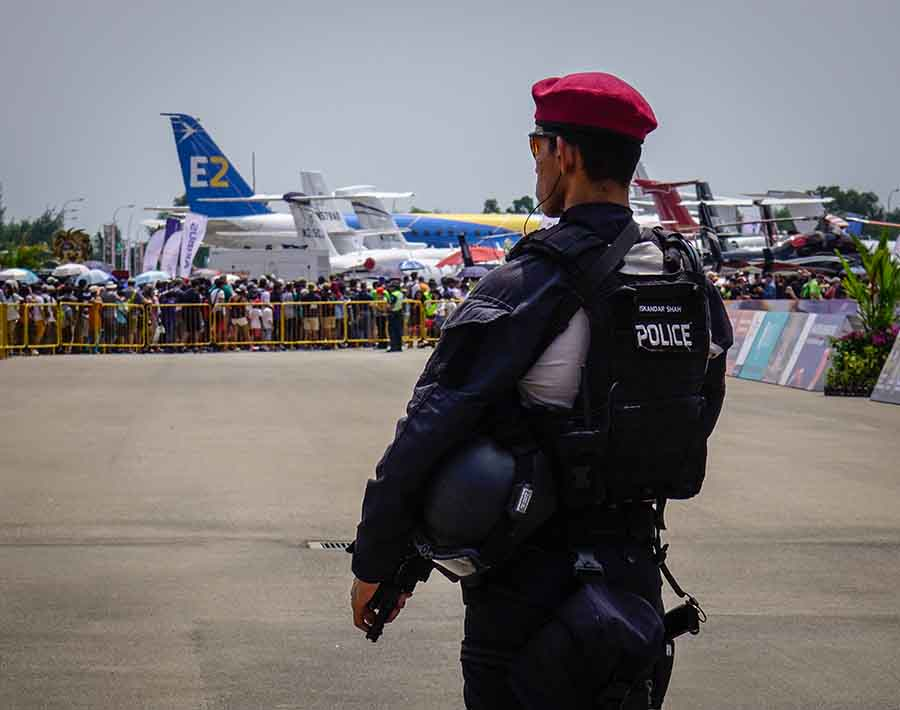 singapore police force overlooking airplanes
