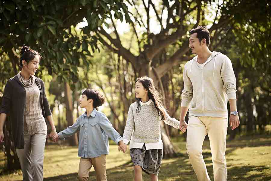 asian singapore pr family of 4 in a park